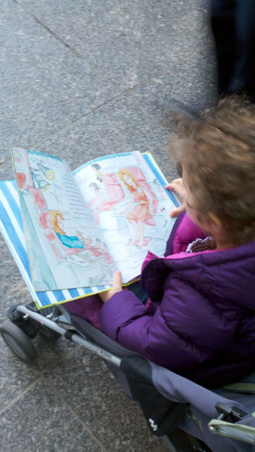 """Reading"" on the stroll home from school!"